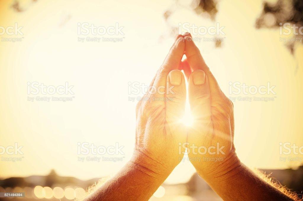 Mains de lumière - Photo
