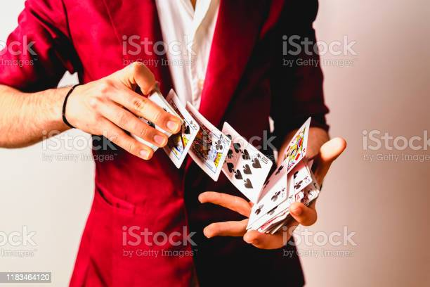 Hands of magician doing tricks with a deck of cards picture id1183464120?b=1&k=6&m=1183464120&s=612x612&h=g7yuz1rletvjiom8ti vdj96dpxx34htiqneawwhyo0=