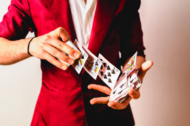Hands of magician doing tricks with a deck of cards. Hands of magician doing tricks with a deck of cards. magician stock pictures, royalty-free photos & images