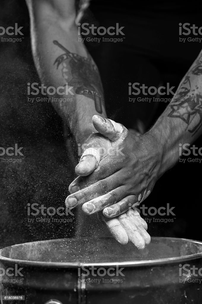 Hands of male athlete with talc powder stock photo