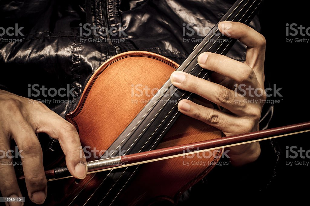 hands of male violinist musician holding classical violin stock photo