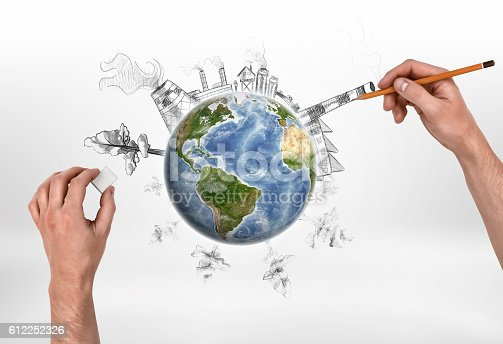 istock Hands of man drawing a factory and erasing trees on 612252326