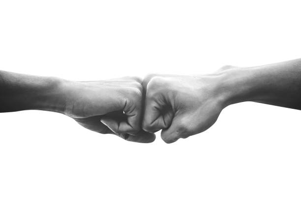 hands of man people fist bump team teamwork and partnership business success, black and white image - forza foto e immagini stock
