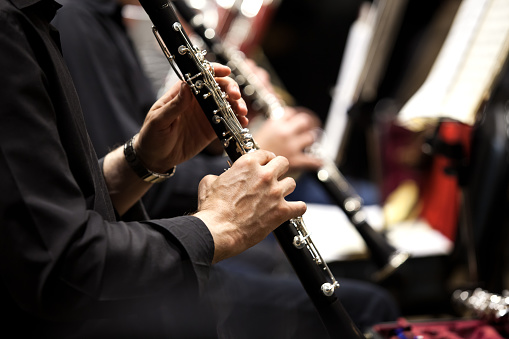 Hands of man playing the clarinet