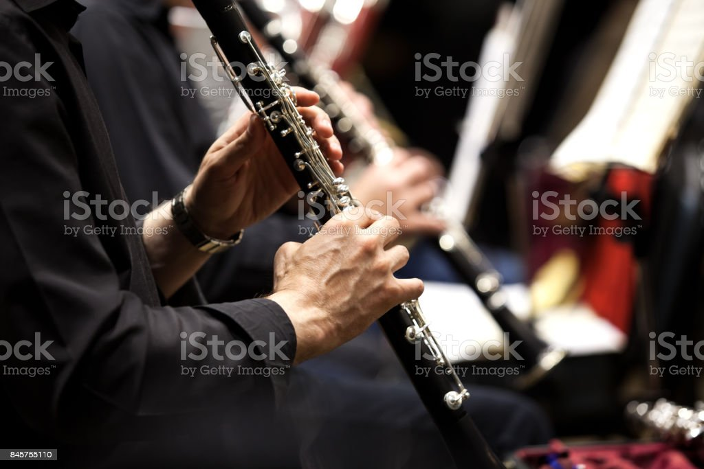 Hands of man playing the clarinet stock photo