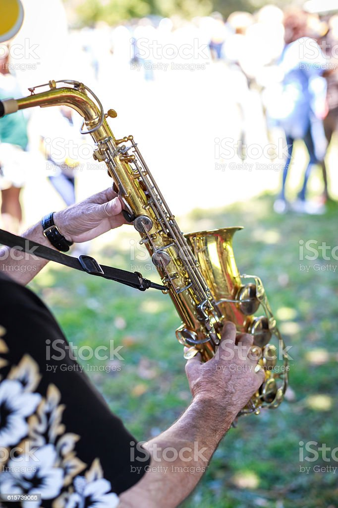 Hands of man playing the saxophone at outdoor stock photo