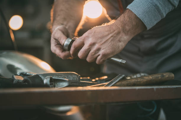 Hands of mechanic Hands of car mechanic repairing car socket wrench stock pictures, royalty-free photos & images