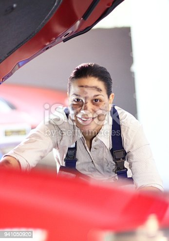 istock Hands of mechanic with wrench repairing engine 941050920