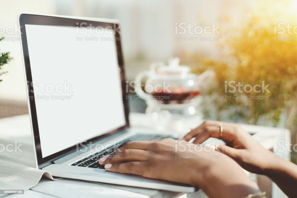 Hands of mixed woman on keyboard of laptop