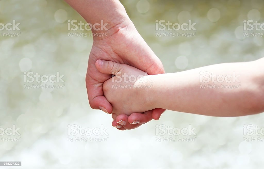 Hands of mother and child stock photo
