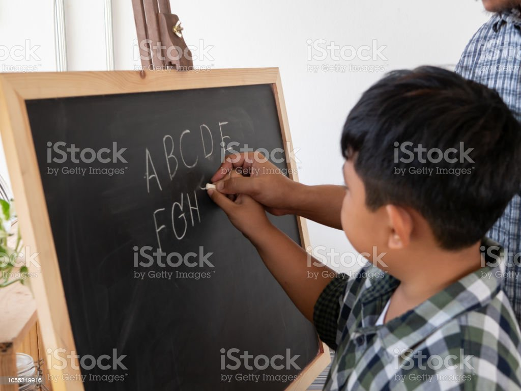 Hands Of My Father And The Boys Are Helping Us Write The Chalkboard