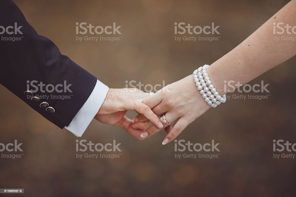 Hands of newlyweds. stock photo