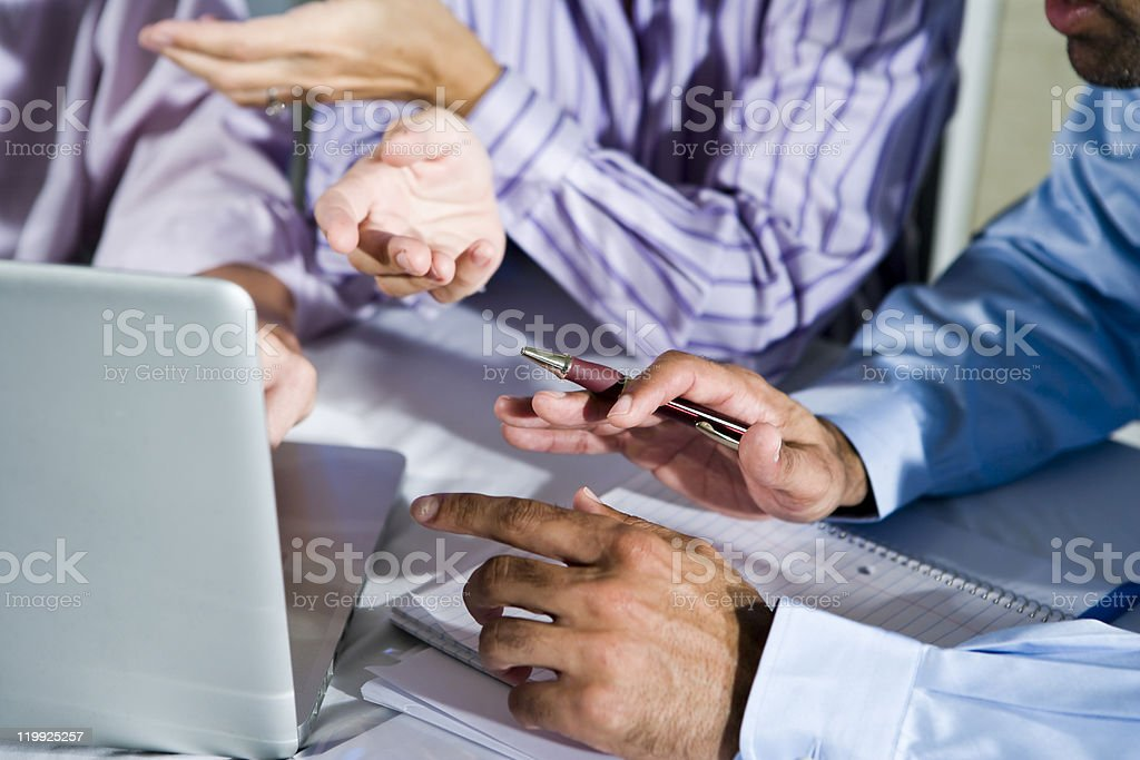 Hands of office workers working on laptop royalty-free stock photo
