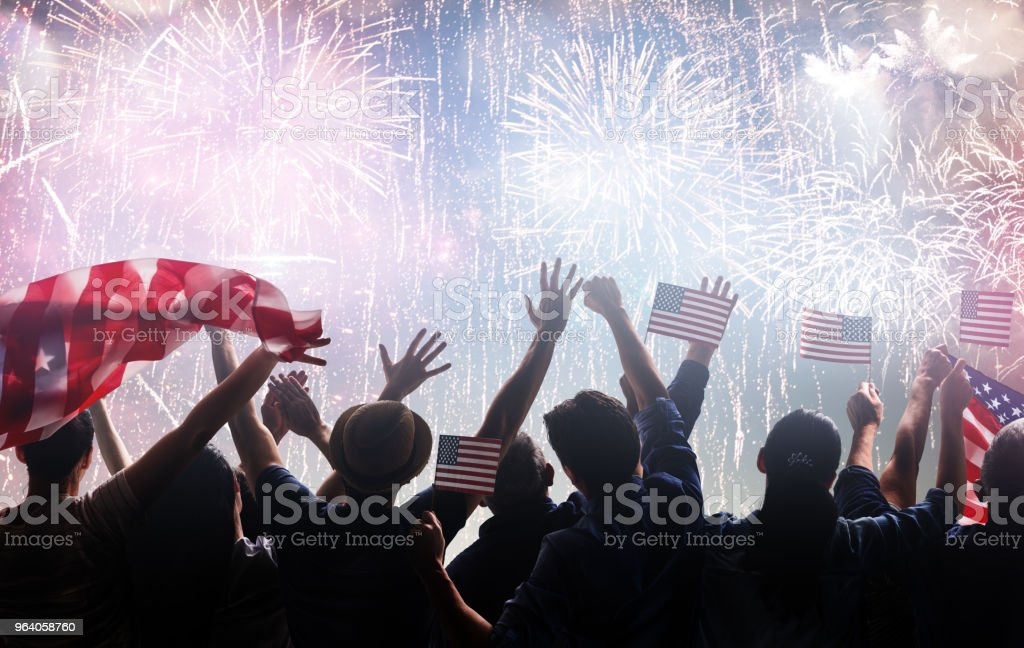 Hands of people holding the Flags of USA. - Royalty-free Adult Stock Photo
