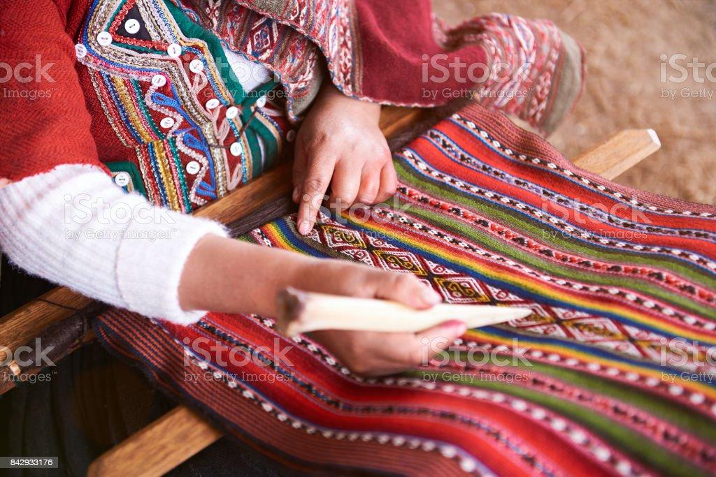 Hands of peruvian woman making alpaca wool stock photo