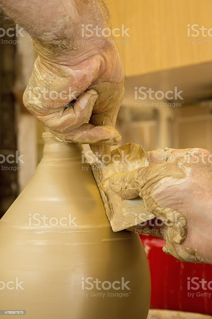 hands of potter at work royalty-free stock photo