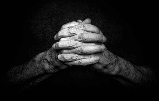 Hands of Praying Man stock photo