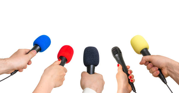 Hands of reporters with many microphones isolated on white stock photo