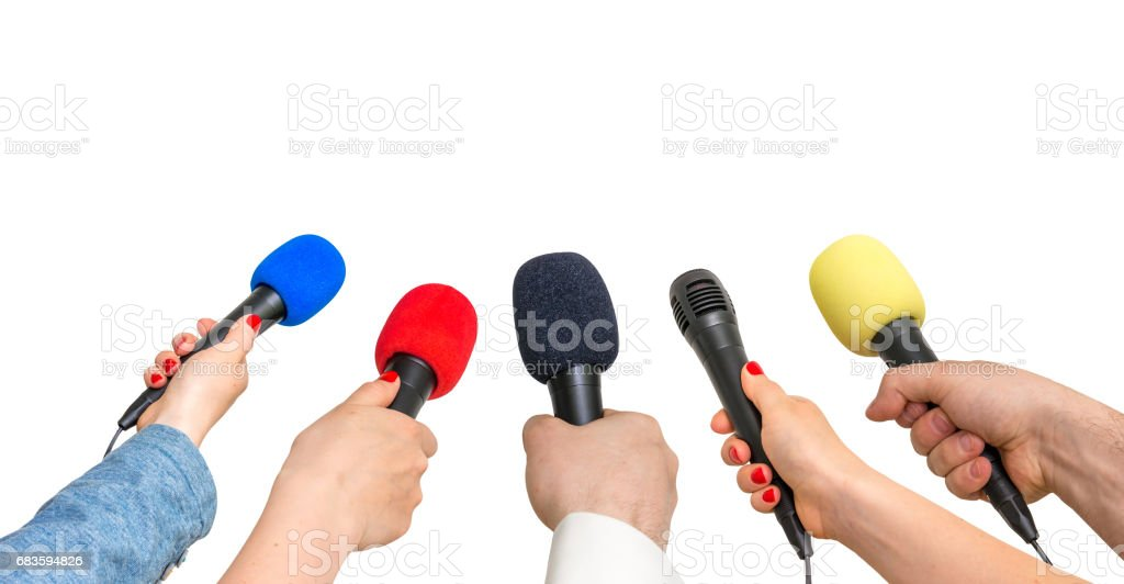 Hands of reporters with many microphones stock photo