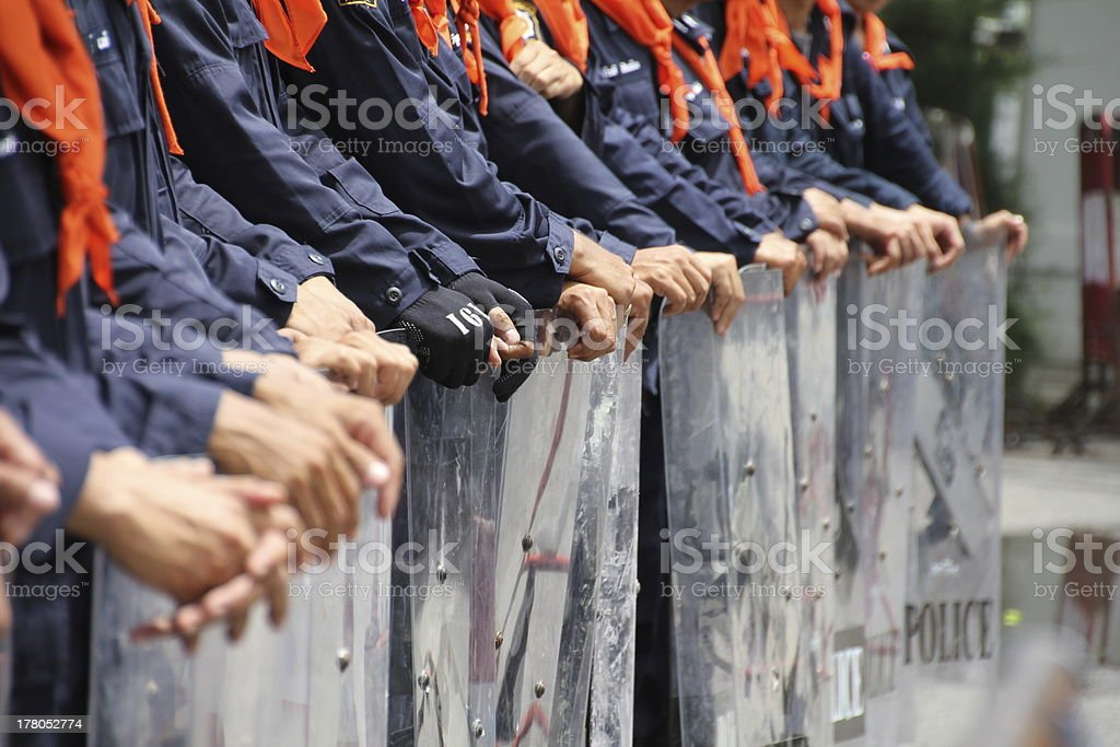 Hands of riot police stock photo