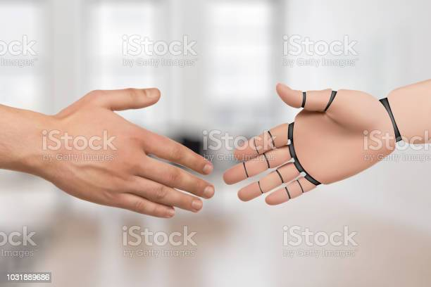 Hands Of Robot And Human Shake Hands Android Artificial Intelligence Stock Photo - Download Image Now