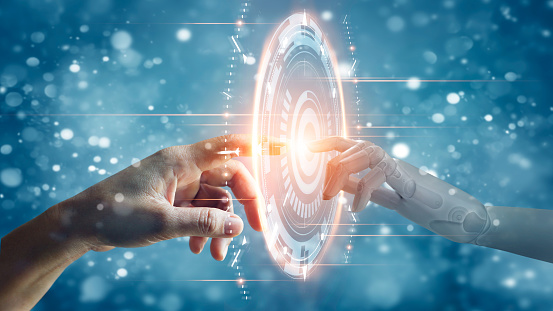 510584002 istock photo Hands of robot and human touching on big data network connection, Science and artificial intelligence technology, innovation and futuristic, AI, Machine learning. 1250153462