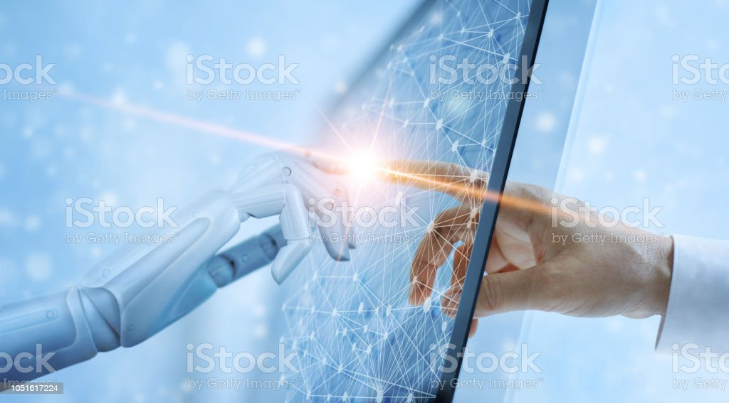 Hands of robot and human touching on global virtual network connection future interface. Artificial intelligence technology concept. stock photo