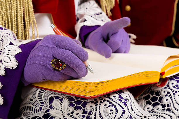 hands of sinterklaas with book Detail Sinterklaas  with empty book.close-up. Dutch character of Santa Claus sinterklaas stock pictures, royalty-free photos & images