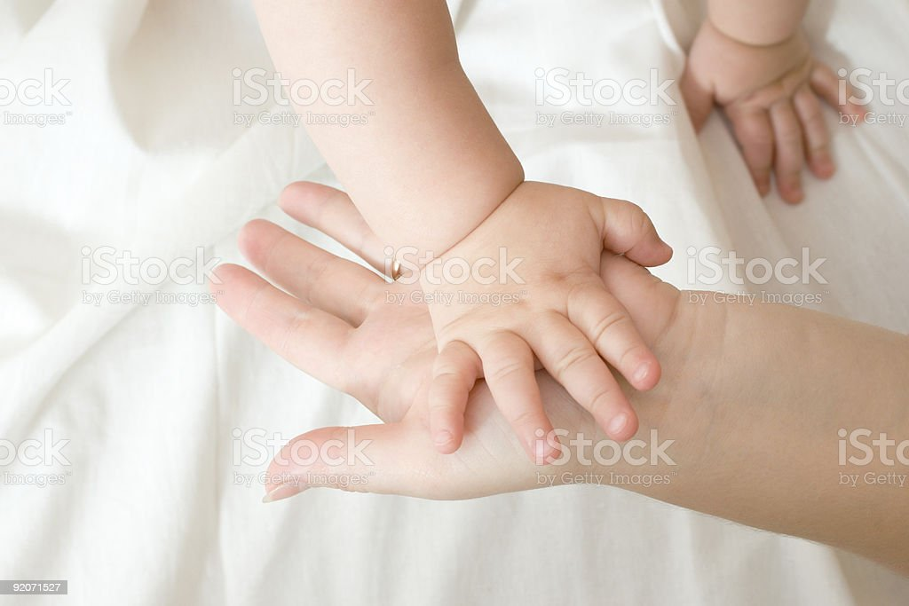 Hands of small baby and mother royalty-free stock photo