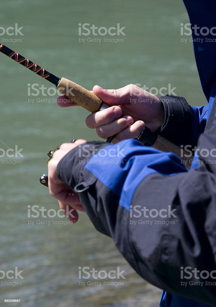 Hands of Sport Fisherman royalty-free stock photo