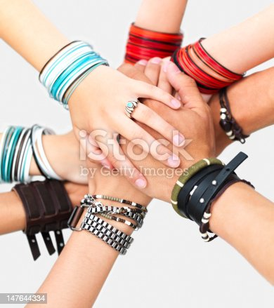 Hands of teenage boys and girls showing unity