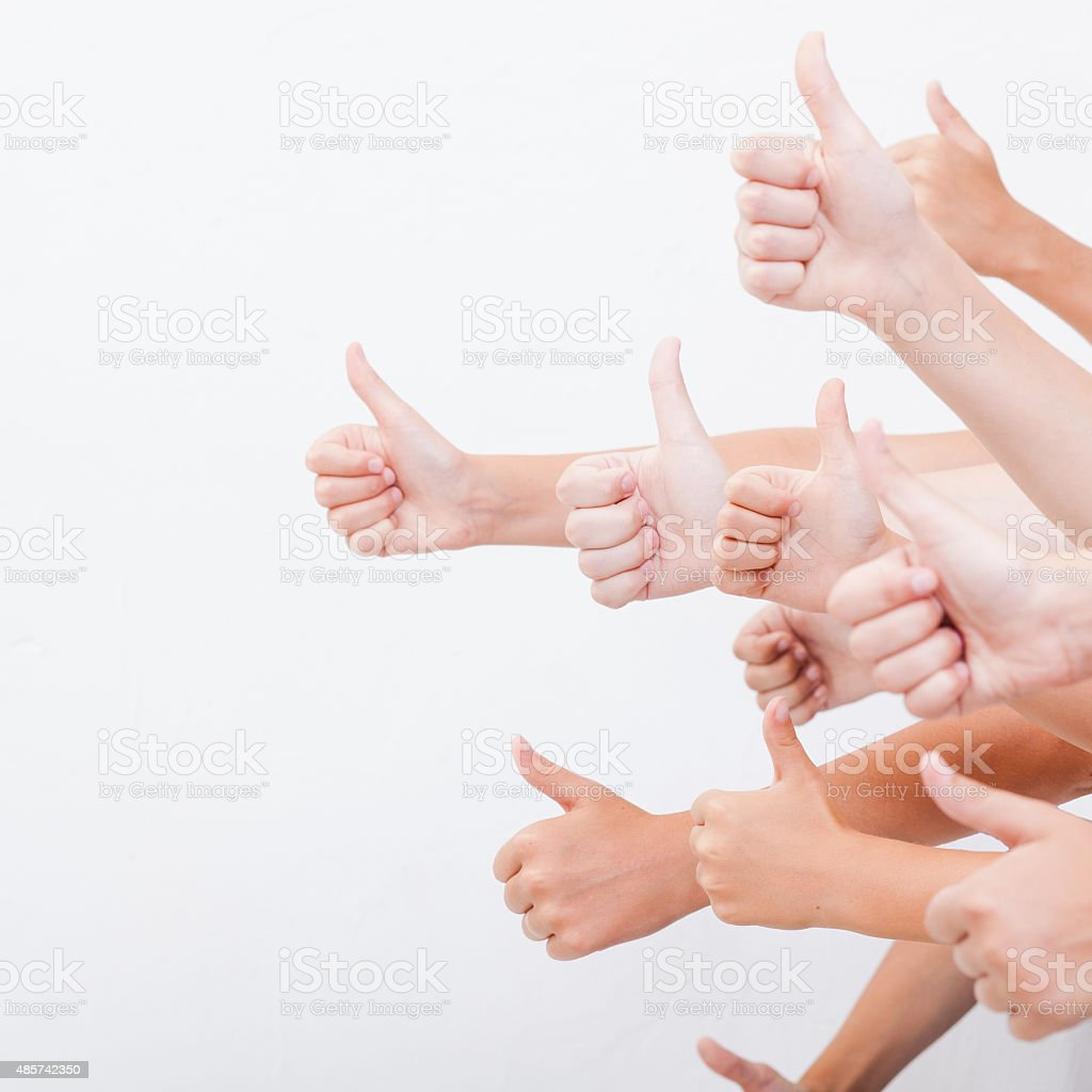hands of teenagers showing okay sign on white stock photo