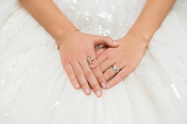 Hands of the bride stock photo