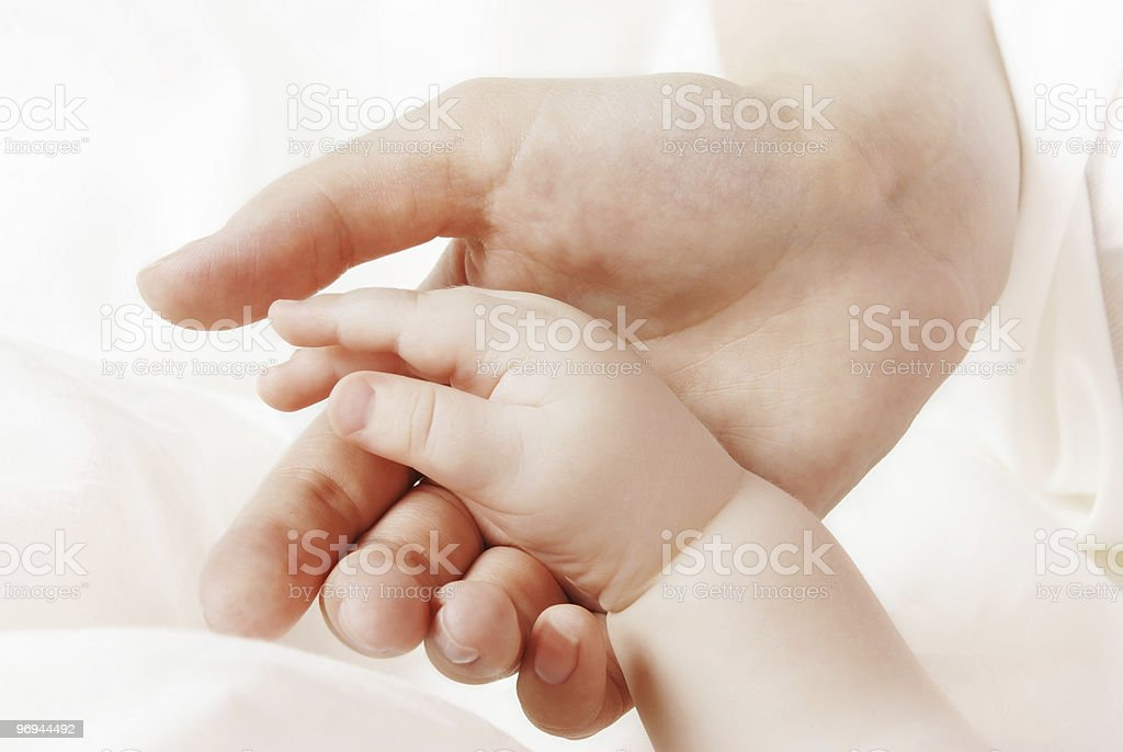 Hands of the child and mother royalty-free stock photo