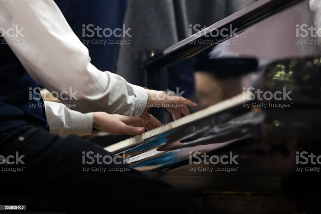 Hands of the child at the piano stock photo