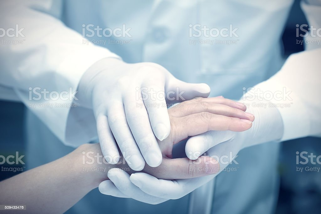 Hands of the doctor and patient stock photo