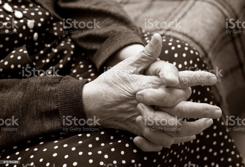 Hands of the elderly woman stock photo