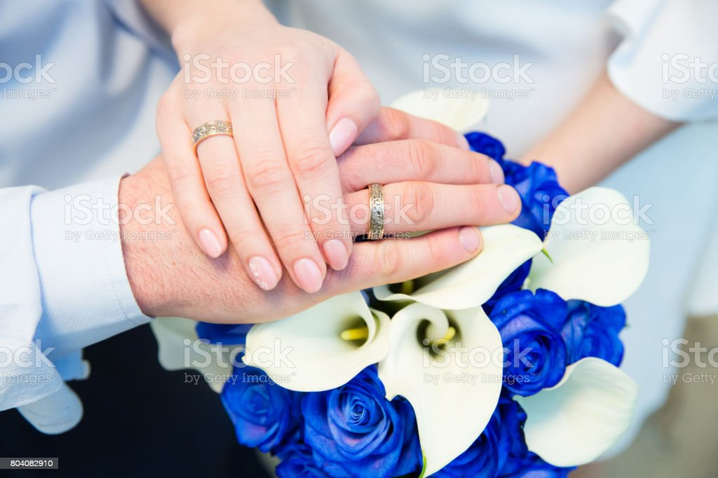 Hands of the groom and bride with rings stock photo