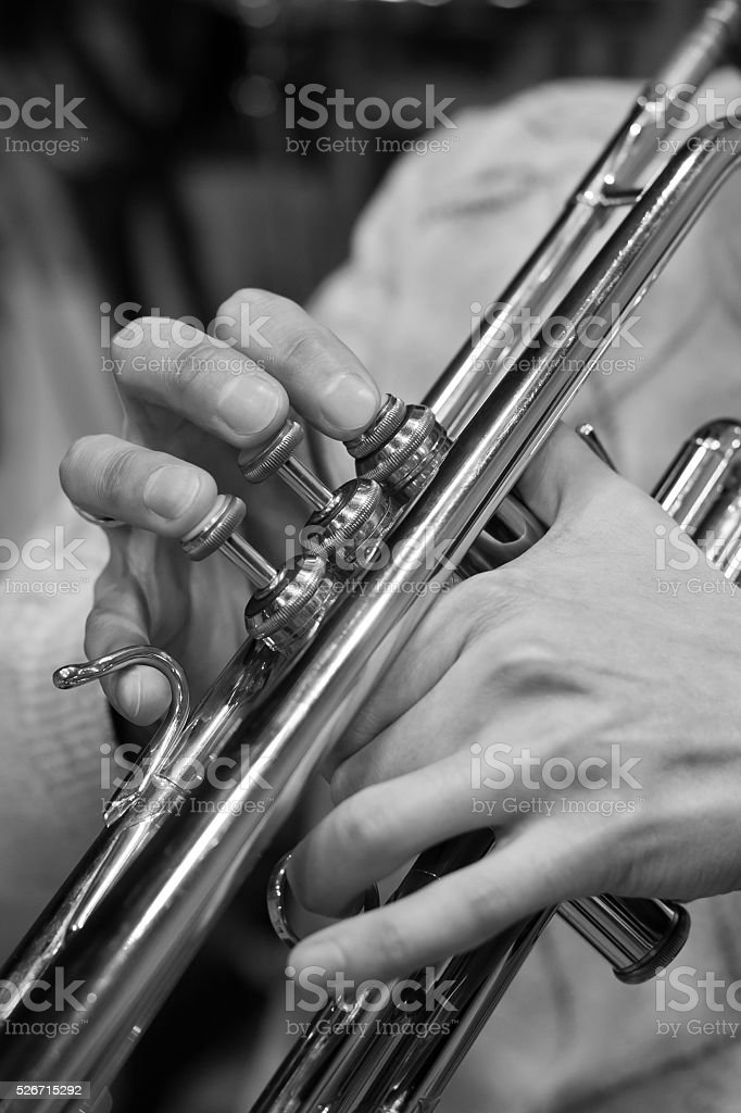 Hands of the musician playing a trumpet closeup stock photo