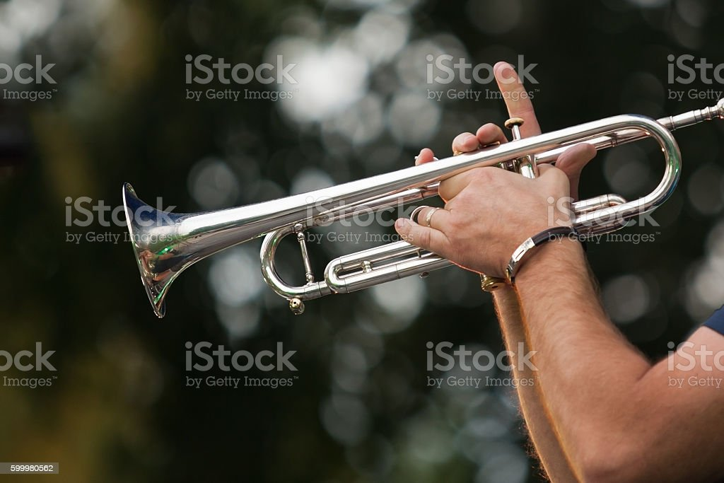 Hands of the musician playing a trumpet stock photo