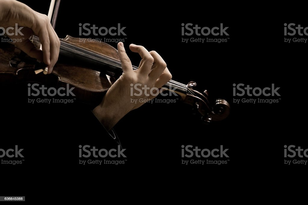 Hands of the musician playing a violin stock photo