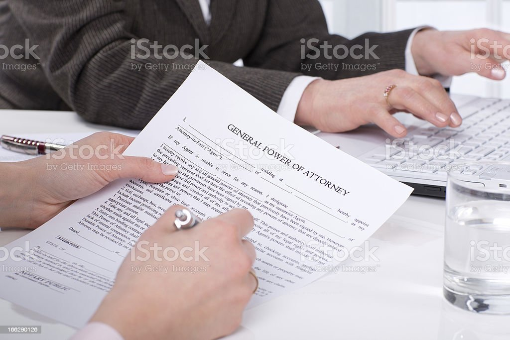 Hands of the woman signature document stock photo