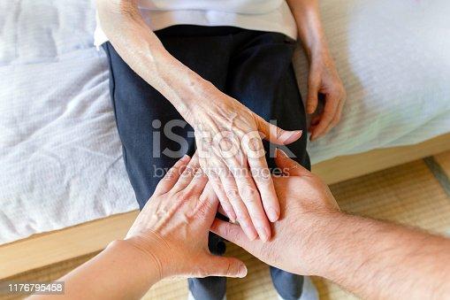 671270528istockphoto Hands of Three Generation, Asian Family 1176795458