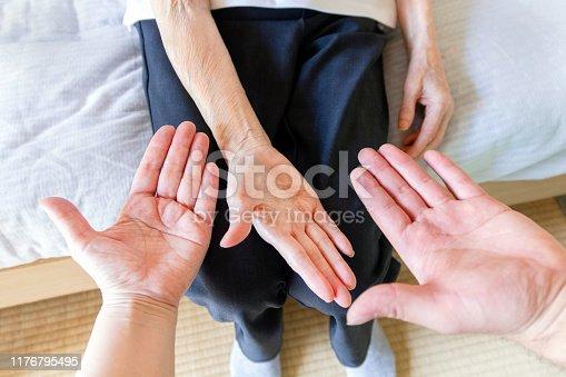 671270528istockphoto Hands of Three Generation, Asian Family 1176795495