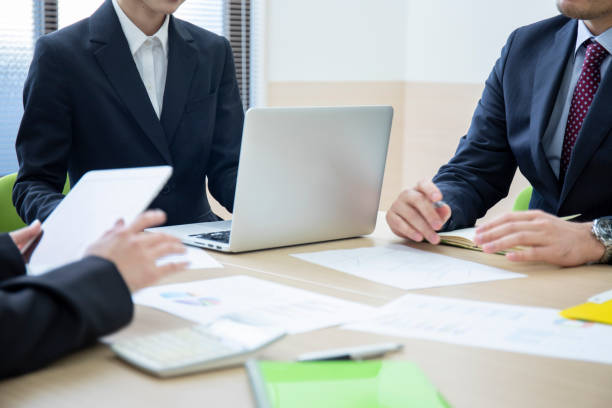 Hands of three men and women meeting in a meeting room stock photo