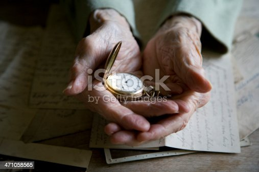 Double exposure of antique pocket watch and old architecture