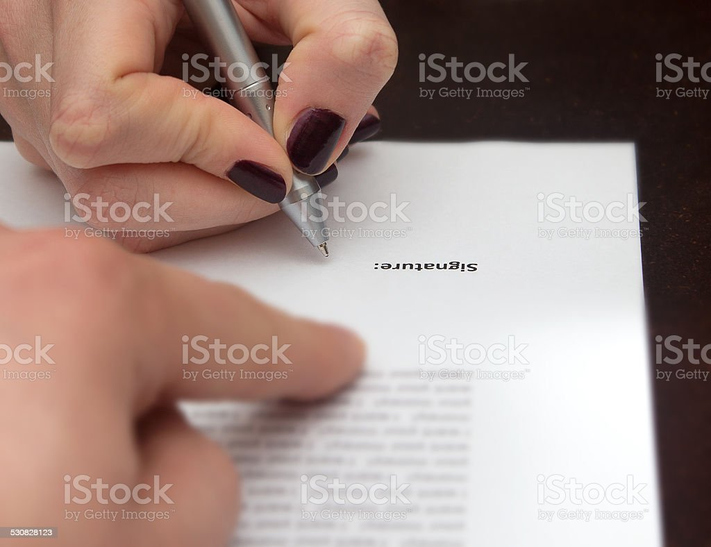Hands of two people signed the document stock photo