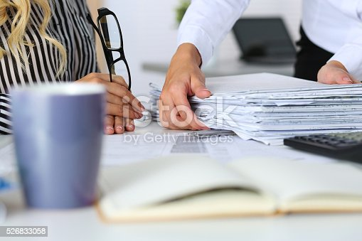 840623374 istock photo Hands of two women in office 526833058