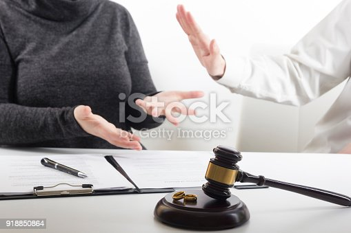 istock Hands of wife, husband signing decree of divorce, dissolution, canceling marriage, legal separation documents, filing divorce papers or premarital agreement prepared by lawyer. Wedding ring 918850864