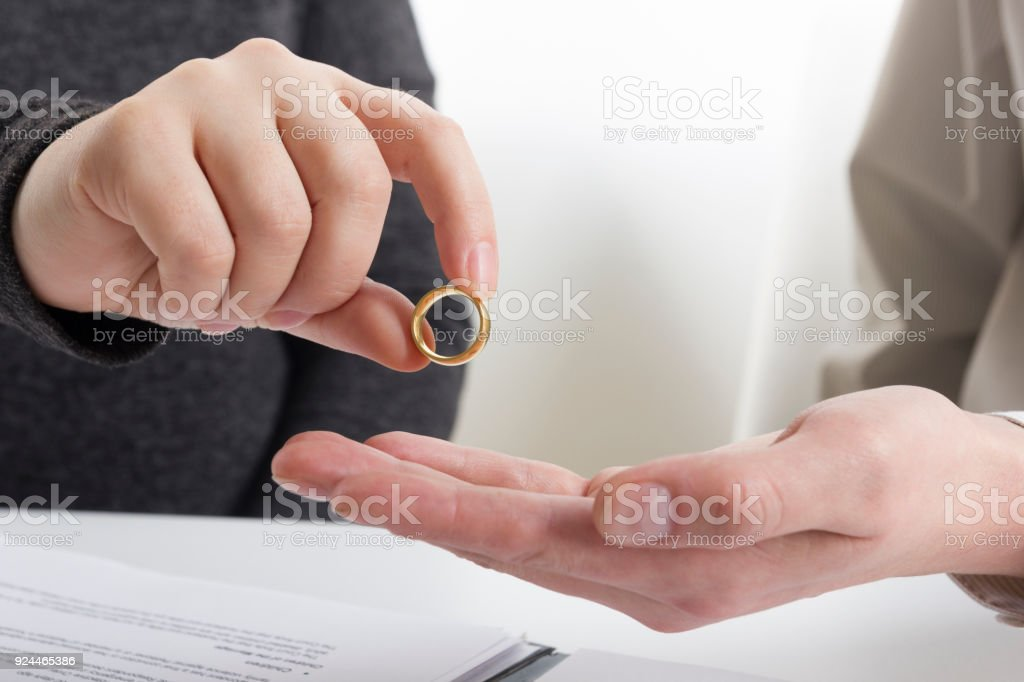 Hands of wife, husband signing decree of divorce, dissolution,...